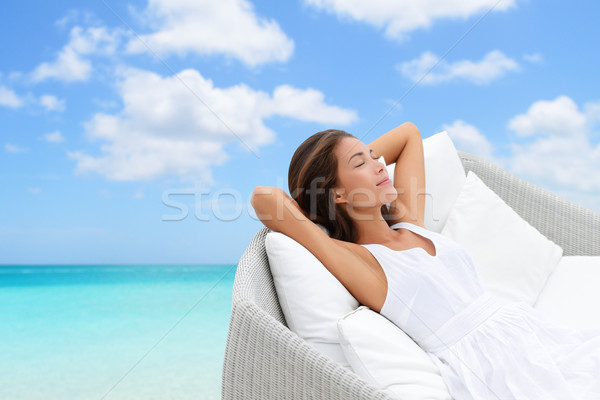 Sleeping woman relaxing lounging on a outdoor sofa Stock photo © Maridav