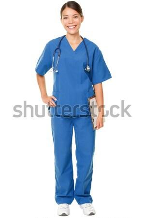 Fiatal orvos kék cserjék stúdiófelvétel fehér Stock fotó © Maridav