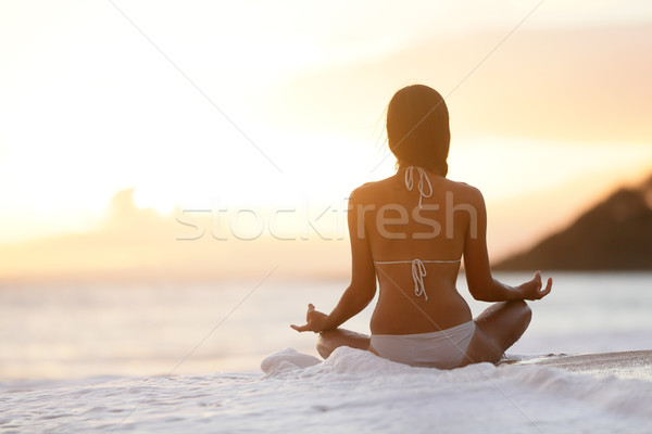 Meditation - Yoga woman meditating at beach sunset Stock photo © Maridav