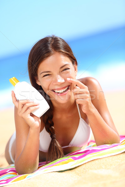 Suntan lotion woman applying sunscreen solar cream Stock photo © Maridav