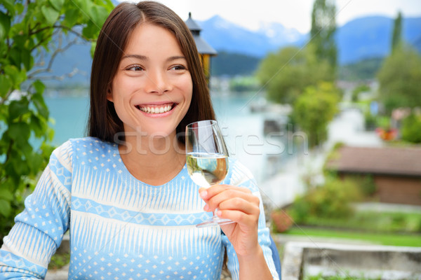 Happy woman smiling as she toasts with champagne Stock photo © Maridav