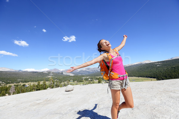 Happy hiking woman dancing in mountain landscape Stock photo © Maridav