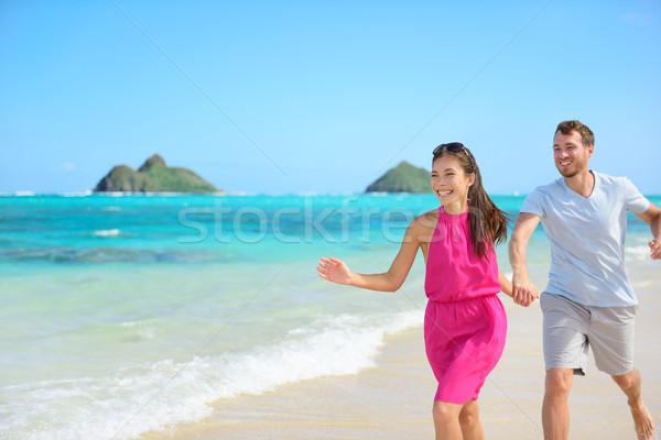 Plaży para szczęśliwy uruchomiony Hawaii Zdjęcia stock © Maridav