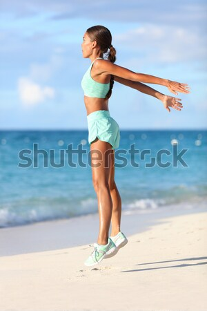 Happy beautiful woman running on the beach Stock photo © Maridav