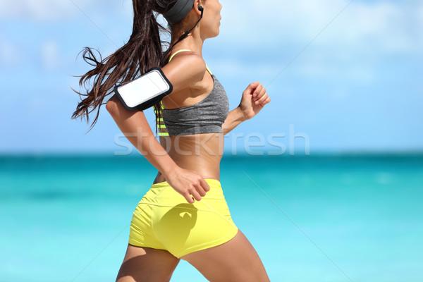 Sportok telefon fitnessz futó testmozgás tengerpart Stock fotó © Maridav