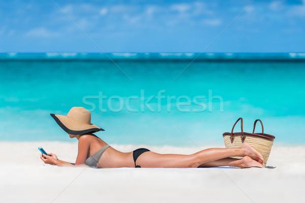 пляж отпуск женщину sms телефон Сток-фото © Maridav