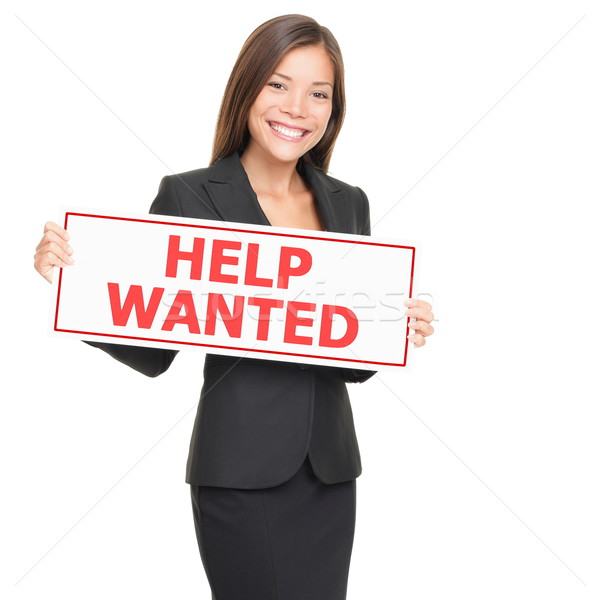 Woman showing help wanted sign Stock photo © Maridav
