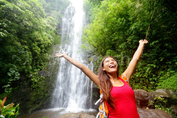 Hawaii woman tourist excited by waterfall Stock photo © Maridav