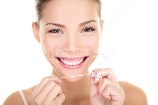 Dental flush - woman flossing teeth smiling Stock photo © Maridav