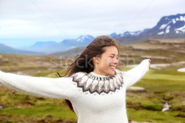 Happy free woman on Iceland in Icelandic sweater Stock photo © Maridav