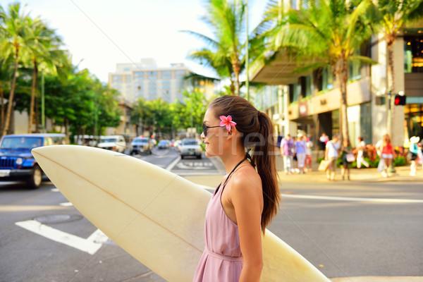 City surf woman surfer with surfboard in Waikiki Stock photo © Maridav
