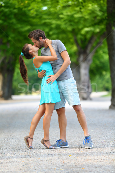 Young couple lovers in love kissing in summer park Stock photo © Maridav