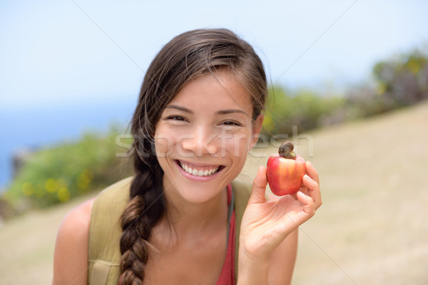 Girl showing natural fresh cashew nut apple fruit Stock photo © Maridav