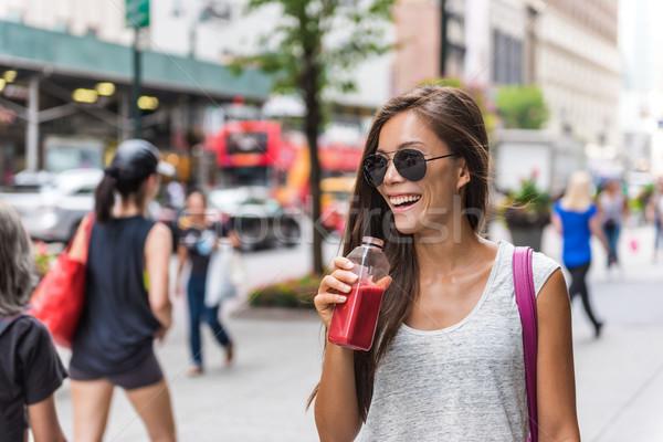City lifestyle woman drinking healthy fruit juice Stock photo © Maridav