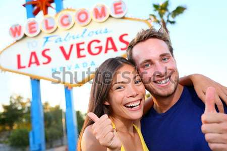 Elvis impersonator man in front of Las Vegas sign Stock photo © Maridav