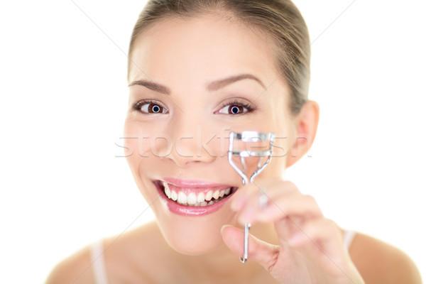 Eye makeup woman using eyelashes curler for mascara. Face care asian beauty girl Stock photo © Maridav