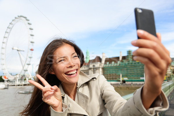 Asian tourist in London taking self-portrait photo Stock photo © Maridav