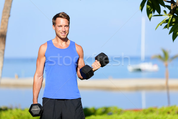 Fitness bicep curl - weight training man outdoors Stock photo © Maridav