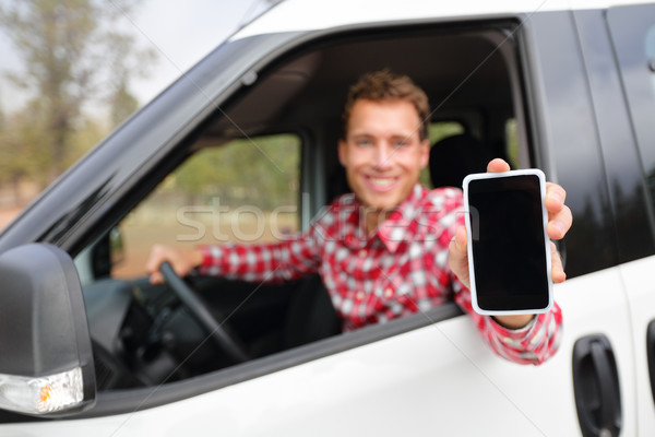 Smart phone man in car driving showing smartphone Stock photo © Maridav