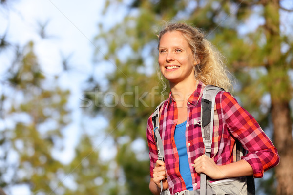 Young happy woman hiker hiking in forest Stock photo © Maridav