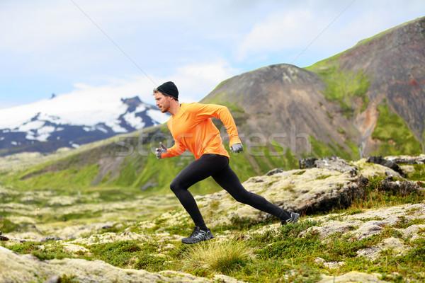 Running man in cross country trail run Stock photo © Maridav
