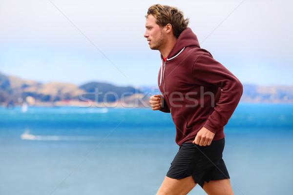 Runner athlete man running in sweatshirt Stock photo © Maridav