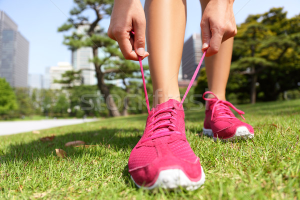 Runner getting ready tying running shoes laces Stock photo © Maridav