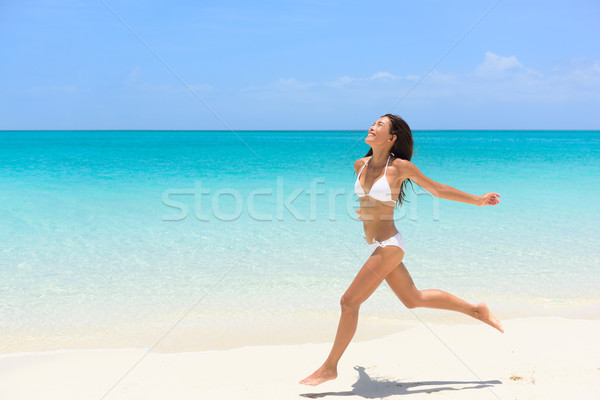 Beach bikini woman carefree running in freedom fun Stock photo © Maridav