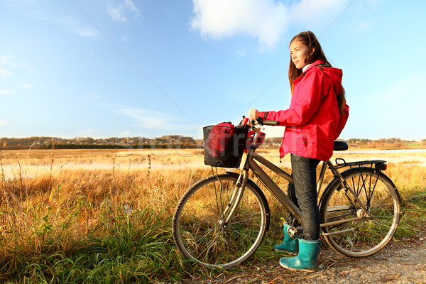 Autumn / fall woman biking Stock photo © Maridav