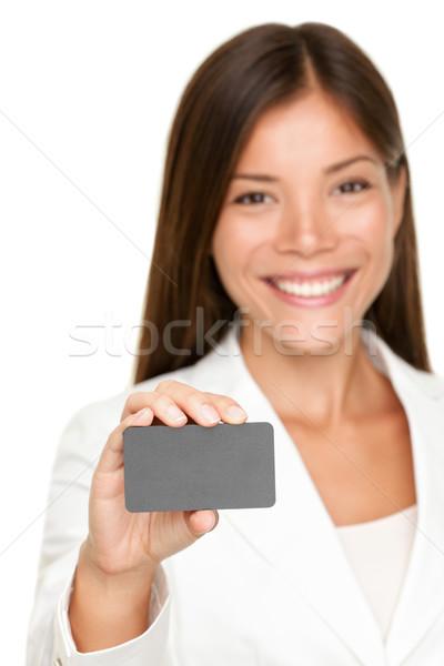 Gülen iş kadını boş kart çekici gri Stok fotoğraf © Maridav