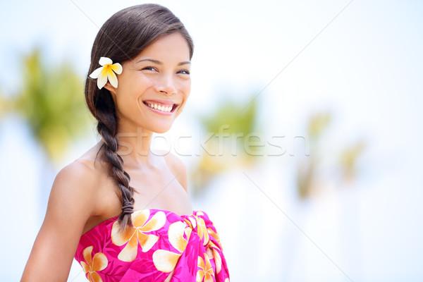 Beach woman smiling happy in sarong Stock photo © Maridav