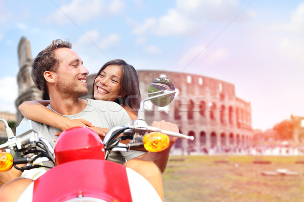 Italy Rome couple on scooter by Colosseum Stock photo © Maridav