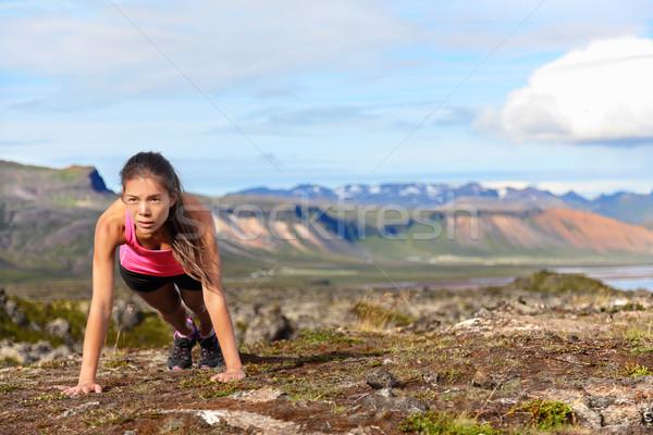 Push-ups fitness woman doing pushups outside Stock photo © Maridav