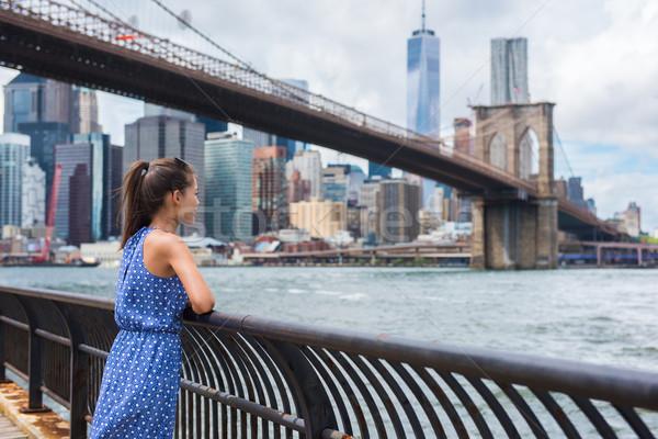 New York city urban tourist woman looking at Brooklyn bridge and skyline Stock photo © Maridav