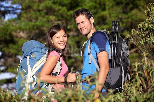 Happy hiking couple smiling Stock photo © Maridav