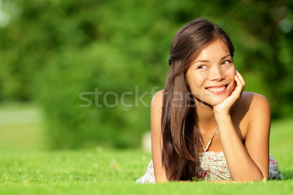 Asian woman lying in grass Stock photo © Maridav