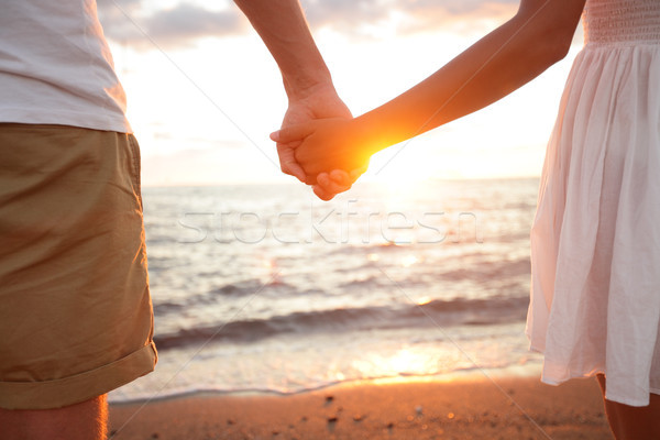Stock photo: Summer couple holding hands at sunset on beach