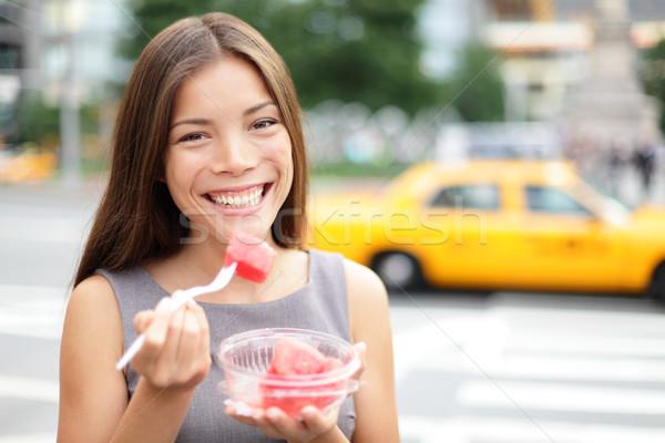 Business woman in New York eating watermelon snack Stock photo © Maridav