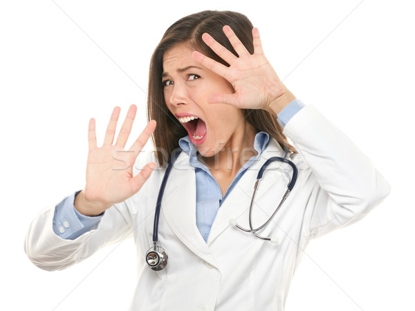 Stock photo: Screaming scared doctor woman afraid