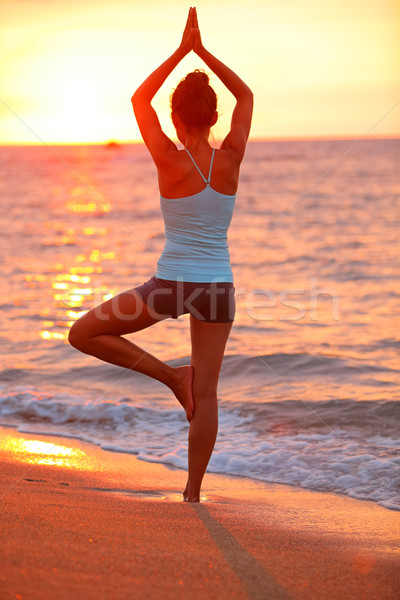 Yoga meditation woman meditating at beach sunset Stock photo © Maridav
