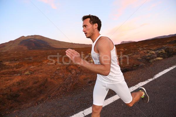 Man running on road in beautiful nature Stock photo © Maridav