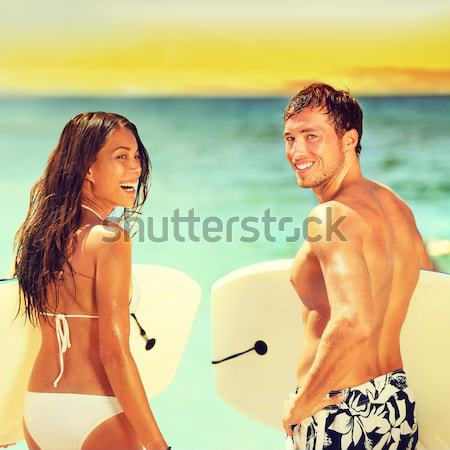 Surfers on beach having fun in summer Stock photo © Maridav