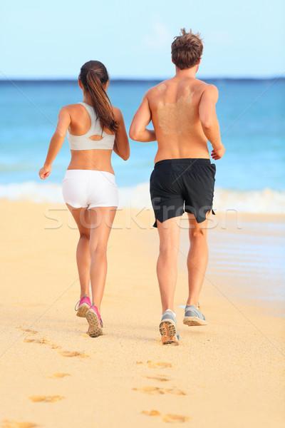 бег работает молодые фитнес пару песчаный пляж Сток-фото © Maridav