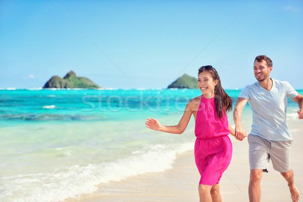 Happy beach fun couple on summer vacation getaway Stock photo © Maridav