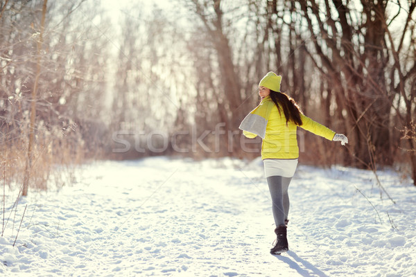 Winter happy woman walking in snow outdoors nature Stock photo © Maridav