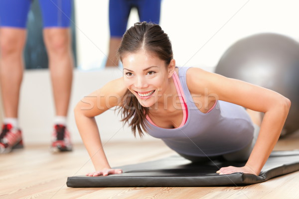 Gym woman working out Stock photo © Maridav