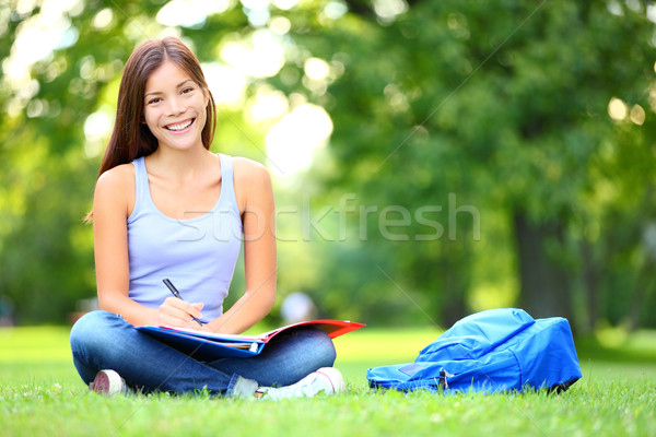 Student studying in park Stock photo © Maridav