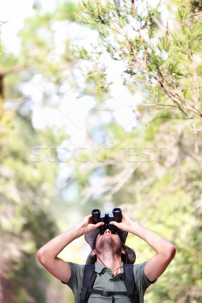 Binoculars - man hiker looking up Stock photo © Maridav