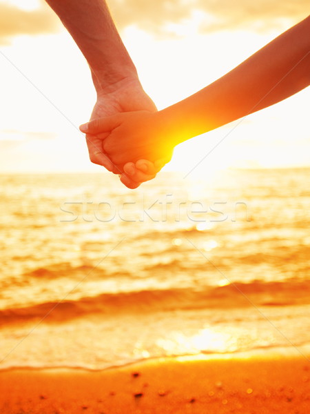 Stock photo: Love - couple holding hands in love, beach sunset