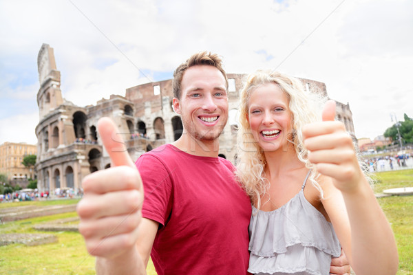 Happy travel couple in Rome by Coliseum in love Stock photo © Maridav